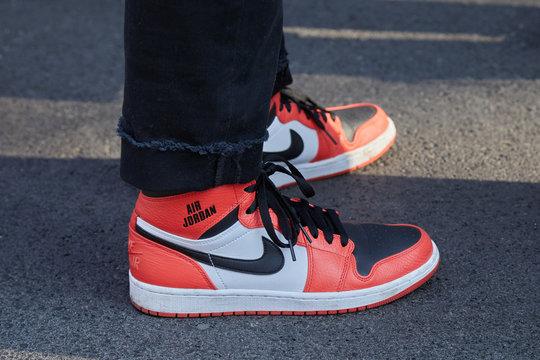 Man with orange Nike Air Jordan shoes on February 27, 2017 in Milan, Italy