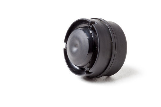 New modern electric black plastic beep - car horn on a white isolated background in a photo studio. Spare part for sale or repair in a workshop or tuning the sound of a beep in a car service.