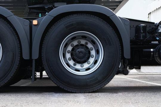 Truck tire, wheel of heavy duty semi truck, close up. Freight industry transport, wheels of modern truck.
