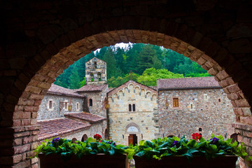 Framed View of Courtyard Walls Through Archway With Flowers at an Italian Style Castle in Napa Valley,Calistoga, California, USA