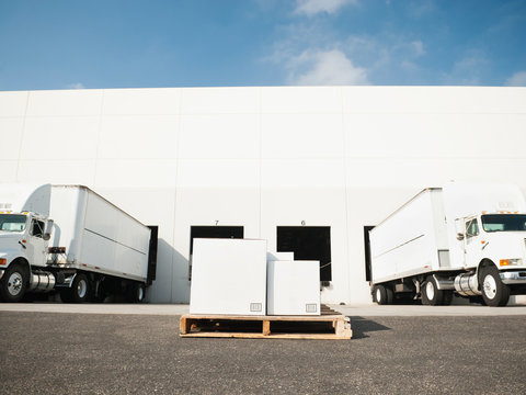 Warehouse with trucks and load