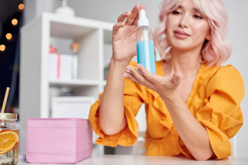 Beauty blogger holding cosmetic product in hands