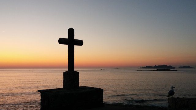 Cross On Beach Against Sky During Sunset