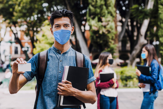 mexican student wearing mask face to prevent infection or respiratory illness, Mexican man with Protection against contagious coronavirus in Mexico Latin America