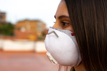 Woman with a doctor mask in the city. Virus Protection.