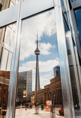 Reflection of CN Tower in a window of a building in Toronto, Canada.