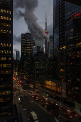 CN Tower, buildings and streets in downtown Toronto, Canada at night.