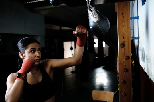 young woman practicing boxing at the gym