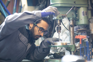 young plumber  technician working in workshop