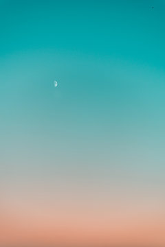 Gradient sky at sunset with Moon
