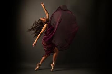 Graceful ballet dancer or classic ballerina dancing isolated