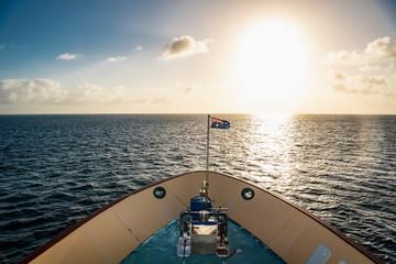 Australian exploration vessel heading into the setting sun