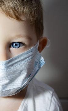 little boy wear a protect mask