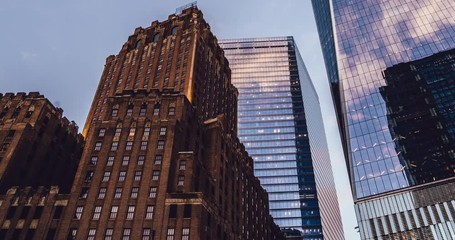 Fotomurales - Zoom in from below on metropolitan corporate buildings in commercial financial district for business lifestyle - Manhattan, modern architecture exterior of high offices with glass windows