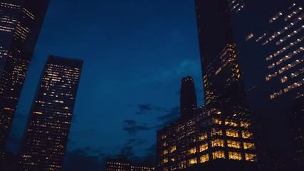 Fotomurales - Manhattan district with modern headquarters from night to morning for showing routine metropolitan lifestyle, time lapse effect of scenic cityscape in American city - New York