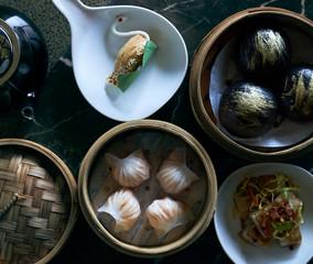 Chinese brunch of dim sum dumplings with tea