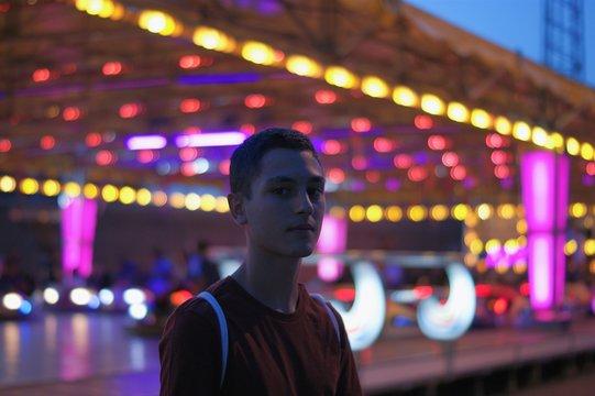 Portrait Of Man Against Illuminated Fluorescent Lights