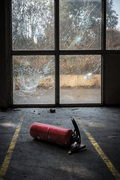 Close-up Of Fire Extinguisher In Abandoned Building