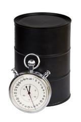 Old stopwatch with Black metallic oil barrel