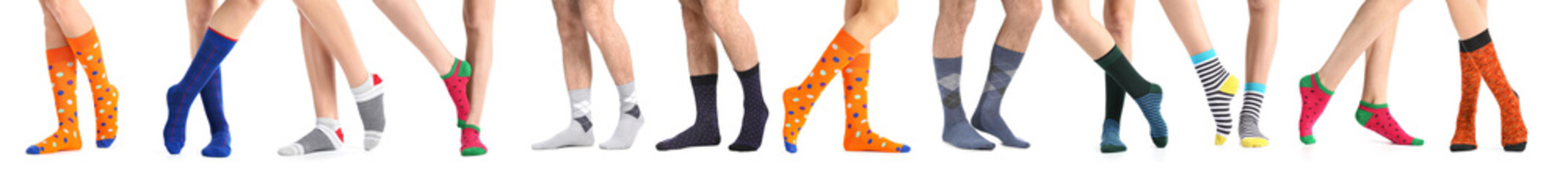 Legs of people in different socks on white background