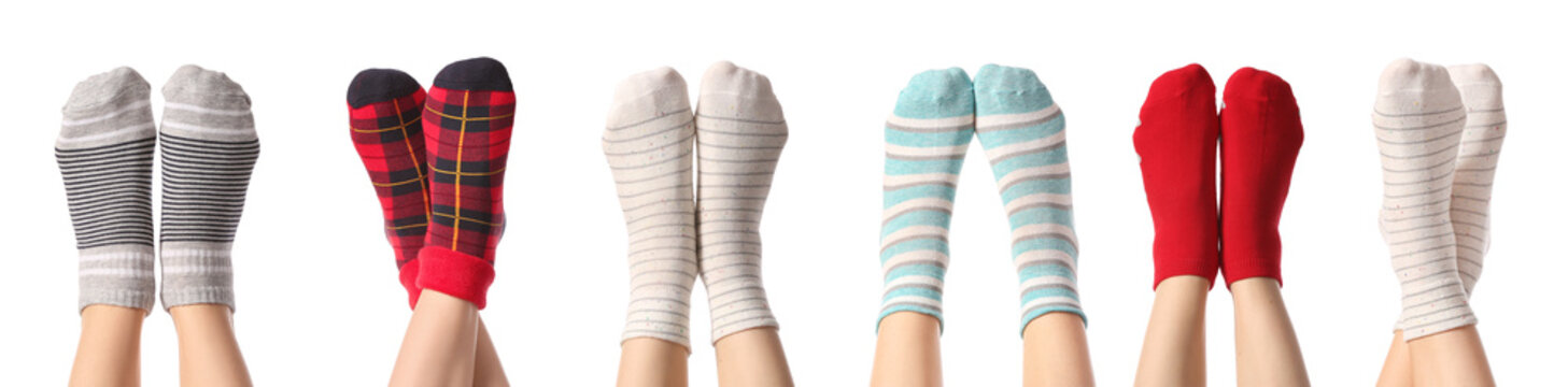 Legs of young women in different socks on white background