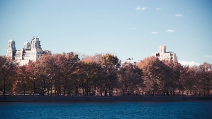 Fototapete - Central Park lake and city buildings on a sunny winter day, Manhattan, New York City, USA, slow motion
