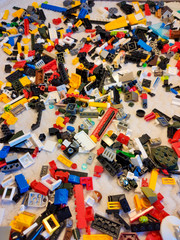 Many small parts from LEGO. Lots of colorful toy bricks. The background is from LEGO.
