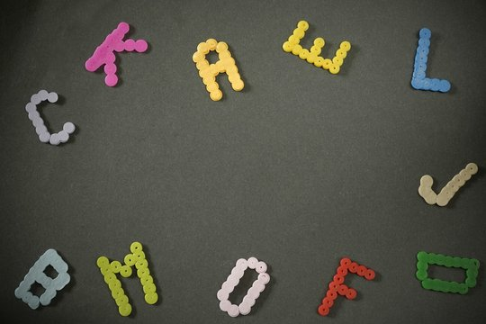 Letters created from colored beads scattered