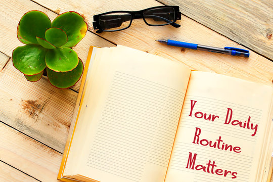 Handwriting text writing Your Daily Routine Matters on notebook
