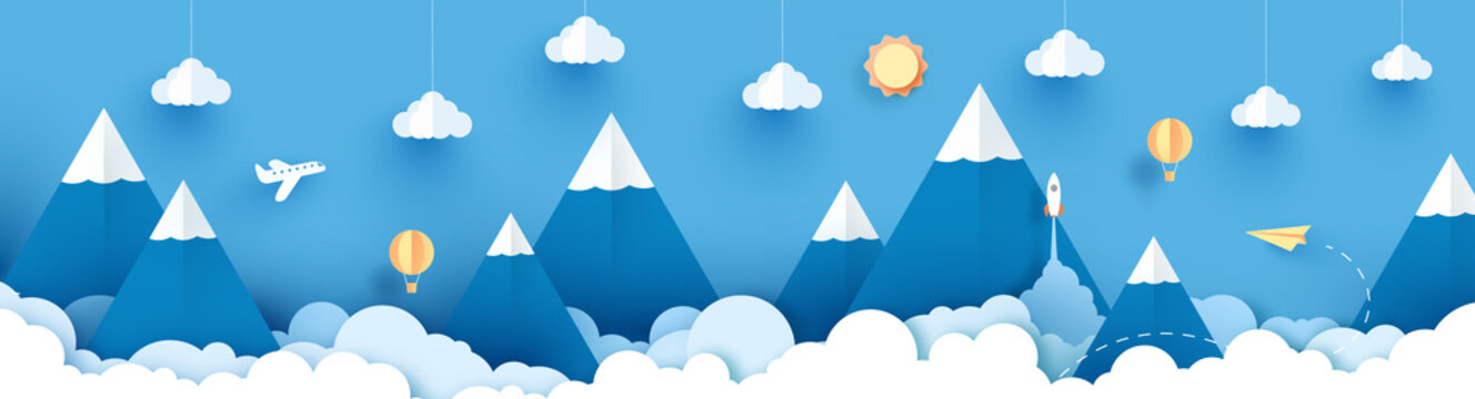 Panorama Winter landscape with paper art style and blue color. View of clouds and mountains. design with art paper and craft. Landscape with high mountains, balloons, paper plane, sun, clouds and