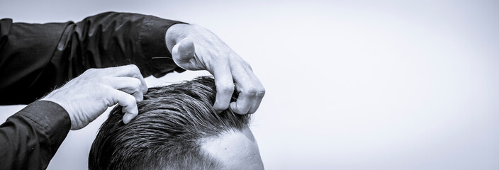 barber at work in barbershop