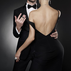 Printed kitchen splashbacks womenART Conceptual photo of sexy elegant couple in the evening suit and dress.