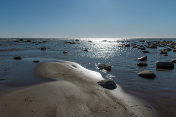 Fototapete - Stones at coast of gulf of Riga, Latvia.