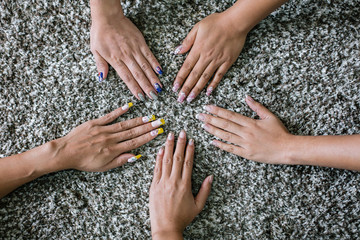 Women hands together at nail salon