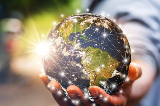 Hand holding flying earth network global connection concept, Energy and ecology concept, Elements of this image furnished by NASA