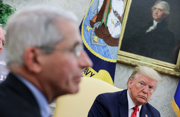 Dr. Anthony Fauci attends Trump-Bel Edwards coronavirus response meeting at the White House in Washington