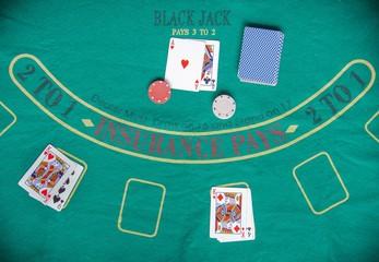 blackjack, card game on green mat