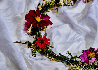 Close up of floral garland on white silk