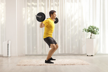 Man exercising with weights at home