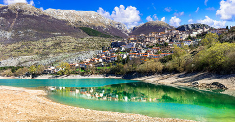 Italy nature. Beautiful emerald lake in Abruzzo mountains and scenic village. Lago di Barrea