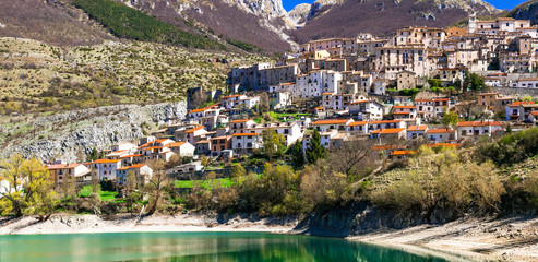 traditional Italy. Beautiful emerald lake in Abruzzo mountains and scenic village. Lago di Barrea