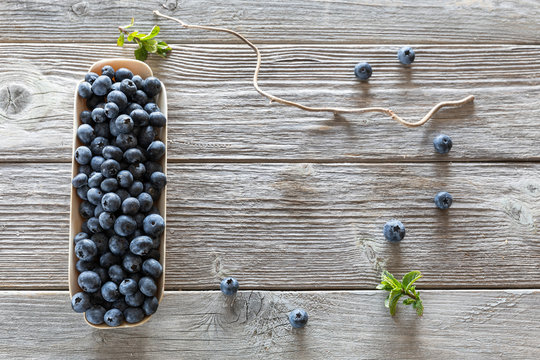 fresh blueberries in a shell on wooden background