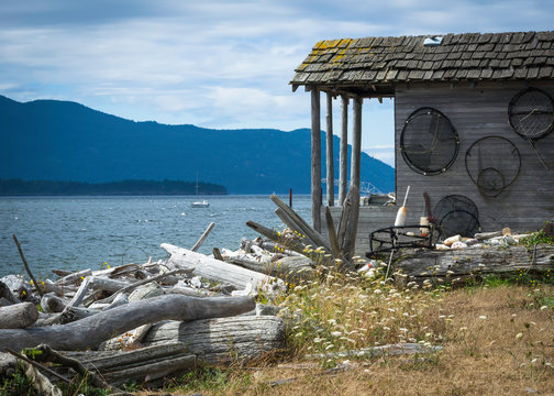 An old boathouse shack has a great view of Legoe Bay from the Lummi Island shoreline, just off the shore of northern Washington State.