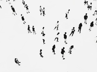 High Angle View Of People Ice-skating On Snowcapped Field - fototapety na wymiar