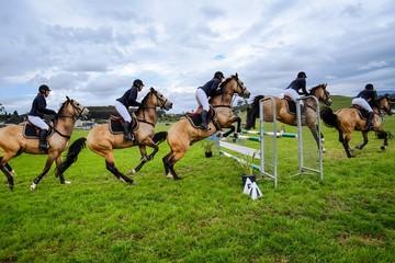 People Horse Racing On Field