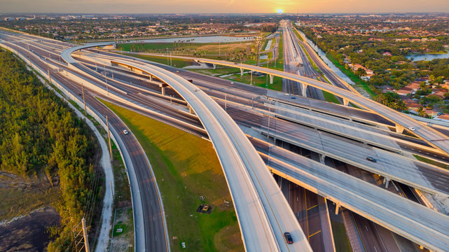 Aerial view on US Roads and Highways Interstate System at sunrise in Doral, Florida, United States