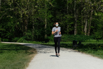 Woman running during coronavirus pandemic with face mask