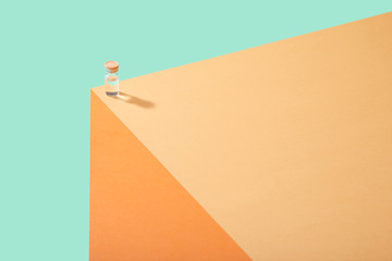 Corona Virus Covid 19 Vaccine Cure in Vial on Counter Table Top Single vial lined up on edge of table surface  bright bold colors Fotobehang