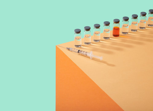 Corona Virus Covid 19 Vaccine Cure in Vial on Counter Table Top Single vial lined up on edge of table surface  bright bold