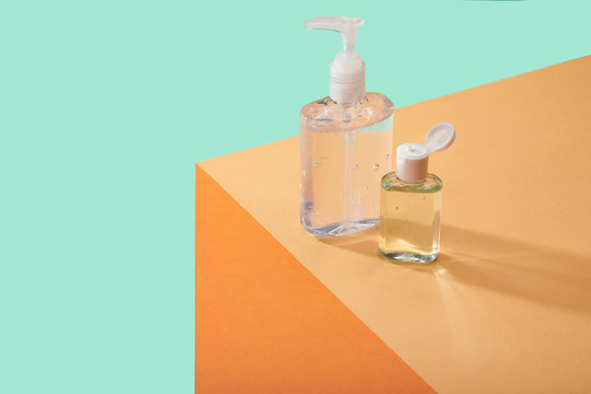 Corona Virus Covid 19 Vacine Cure Hand Sanitizers Cleansers Anti Bacterial Containers on Table Counter Top Hand sanitizers on edge of table surface  bright bold colors